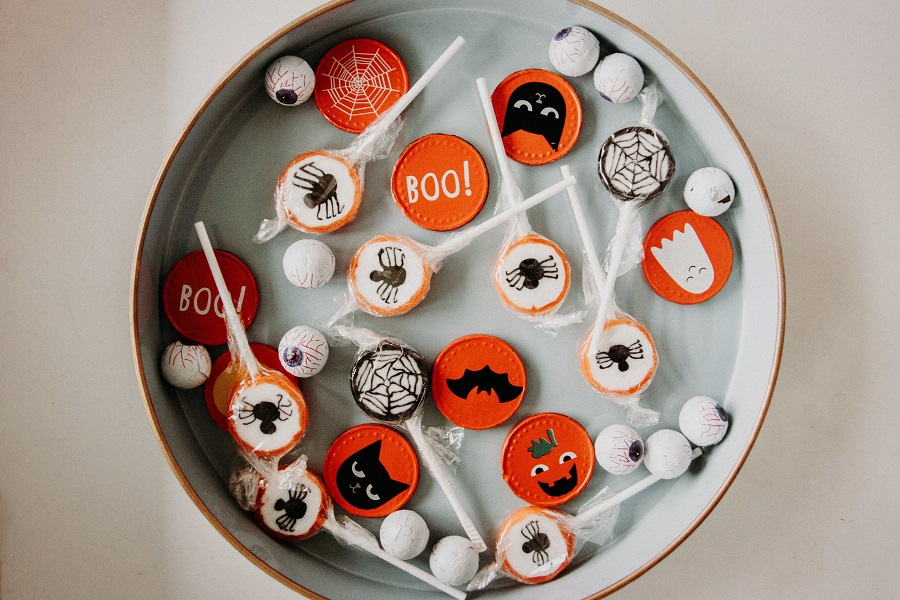 Instant Pot Halloween Recipes Overhead View of a Platter with Halloween Candy Scattered Around on it
